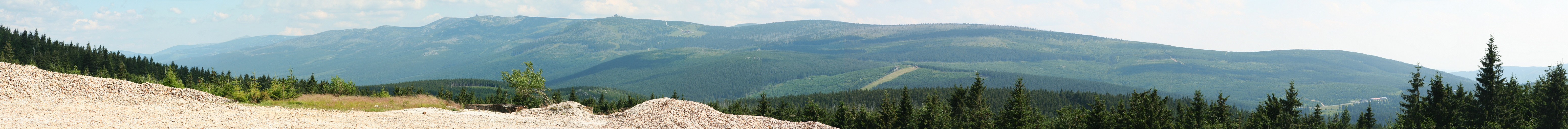Panorama of the Karkonosze (Giant Mountains) from the 'Stanislaw' open-pit quartz mine in the Izera Mountains